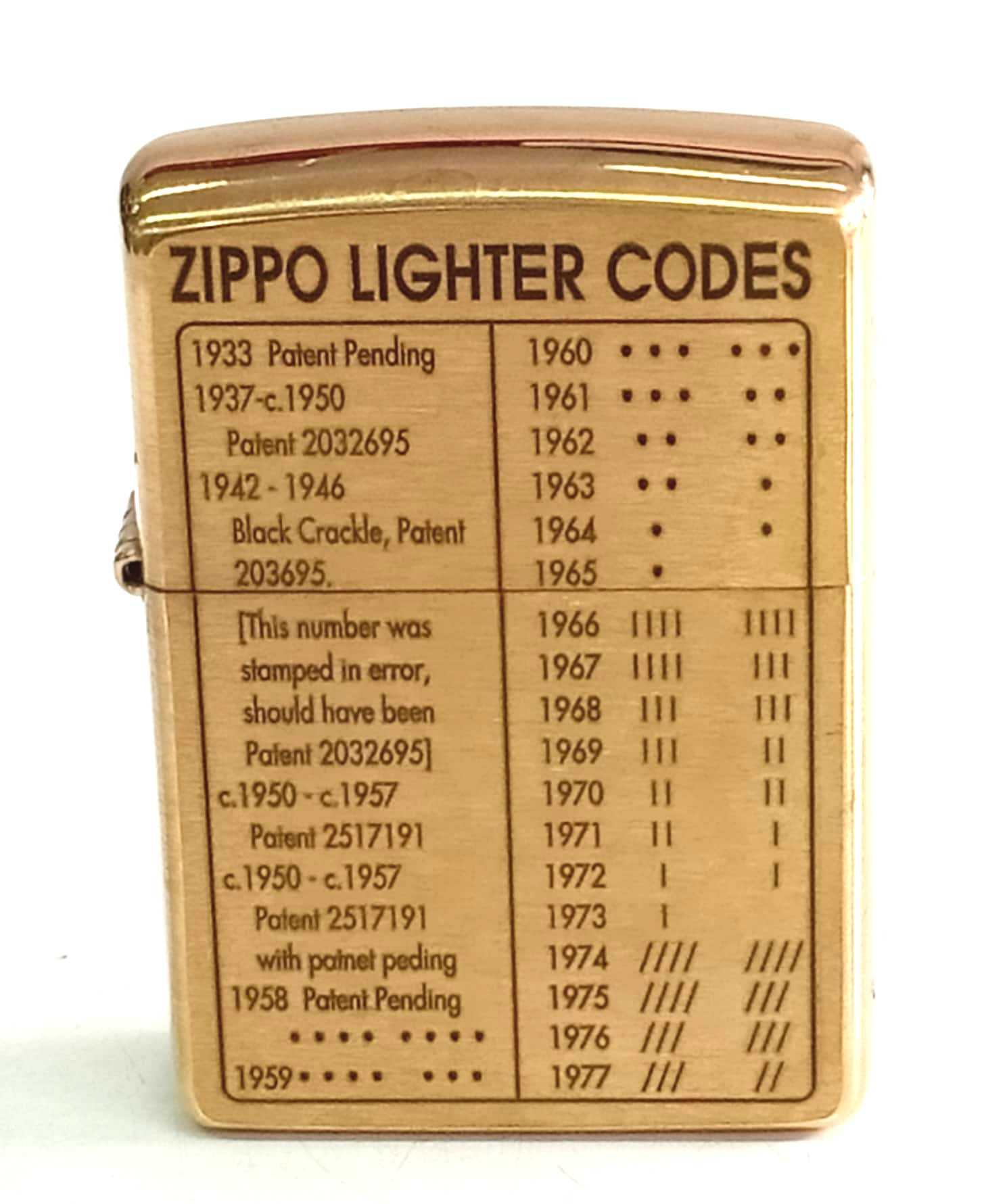 Zippo vang khac 2 mat moc day zippo Z823 1